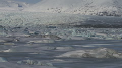 Pan across glaciers and ice field with snow covered hills. Stock Footage