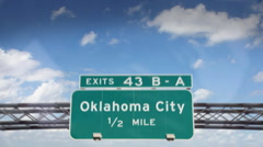 A Highway/Interstate sign going into the city of Oklahoma City, Oklahoma Stock Footage
