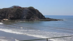 Pan of ocean to beach at resort in Mazatlan, Mexico Stock Footage