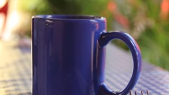 Blue Coffee Cup steaming in the morning (HD) Stock Footage