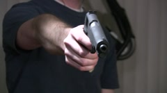 Shooting a gun toward the camera Stock Footage