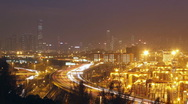 Hong kong skyline and container terminal at night Stock Footage