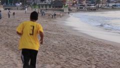 People enjoying the beach in Mazatlan, Mexico Stock Footage
