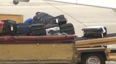 Loading Baggage Onto Plane Stock Footage