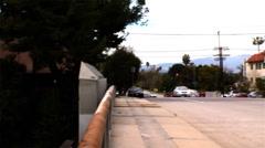 Pan and tilt down across LA freeway traffic  Stock Footage