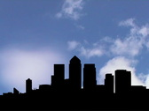 Stock Video Footage of London Docklands skyline with timelapse clouds animation