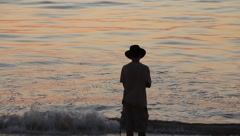 Silouette of Boy by the Ocean Stock Footage