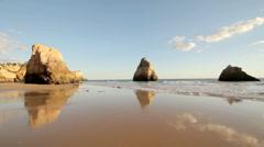 Rocks and ocean in Alvor Portugal Stock Footage