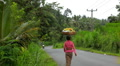 A Balinese Woman Carrying a Basket of Fruit On Her Head, Bali, Indonesia Footage