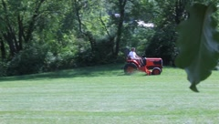 Man Mow Lawn on Lawn Tractor (HD) co Stock Footage