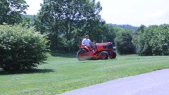Man mows yard with red lawnmower (HD) k Stock Footage
