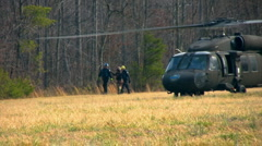 Victim carried from helo - stock footage