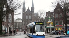Tram or streetcar in Amsterdam, Holland Stock Footage