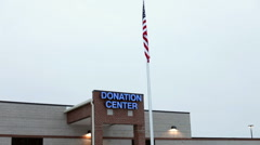 Flag in front of Donation Center Stock Footage