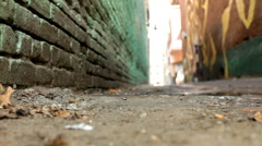 Jumping camera and running down alley Stock Footage