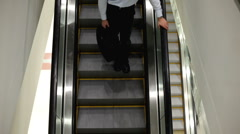 Overhead view of Person going down escalator Stock Footage