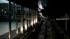 Train pulling out of station at night Stock Footage