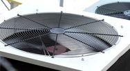 Stock Video Footage of Outside Air Conditioner fan blade spinning