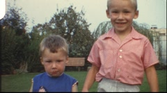 Brothers holding hands (vintage 8 mm amateur film) - stock footage