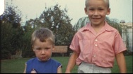 Stock Video Footage of Brothers holding hands (vintage 8 mm amateur film)