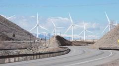 Windmill traffic mountain road P HD 8832 Stock Footage