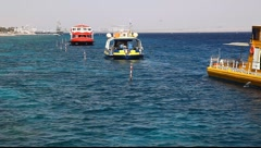 Glass boats in Eilat, for observing of fish, dolphin, shark and corals Stock Footage