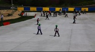 Skiing and snowboarding on artificial snow Stock Footage