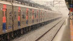 Subway Leaving Station on a Snowy Day (HD) co Stock Footage
