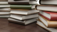 Books on the table in library Stock Footage
