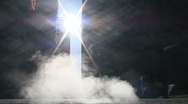 Steam rises from a manhole cover into the Wall Street Sunlight Stock Footage