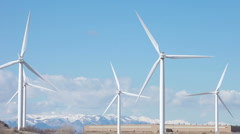 Windmills with cars passing P HD 8842 Stock Footage