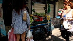 Man Selling Tropical Fruits, Colourful Street Food Life in Bangkok, Thailand Stock Footage