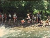 Kids throwing stones in river, 1960s (vintage 8 mm amateur film) Stock Footage