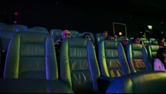 Watching movie in Imax 3D cinema theatre in Eilat, Israel Stock Footage