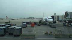 Airport tarmac baggage to plane - stock footage