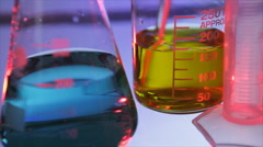 Stirring Yellow Liquid in Lab Beaker Stock Footage