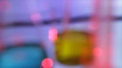 Rack focus to lab beaker Stock Footage
