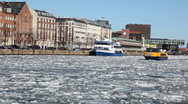 Harbourbus in icy canal Stock Footage