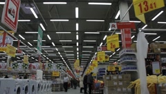 Buyer in supermarket (can be used for timelapse) - stock footage