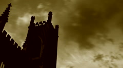 Timelapse clouds flowing past derelict church steeple Stock Footage