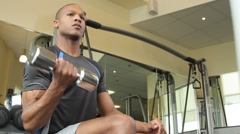Male lifting weights in gym and drinking water Stock Footage