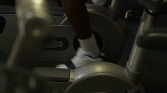 Male work out on bicycle in a gym Stock Footage