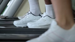 Feet running treadmills cardio workout exercise in gym Stock Footage