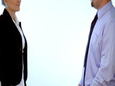 Businessman and businesswoman shaking hands, isolated  Stock Footage