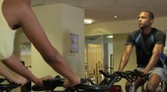 Stock Video Footage of Spinning class with male coach in gym