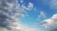 Rotated white clouds floating on blue sky - motion background Stock Footage
