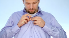 Stock Video Footage of Young businessman tying necktie, timelapse
