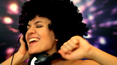 Woman with afro and headphones listening to the music, slow motion, animated bg Stock Footage