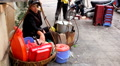 A Woman cooking in the street, Colourful Street Food Life in Hanoi, Vietnam Footage