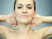 Attractive sexy woman with hands on her neck posing Stock Footage